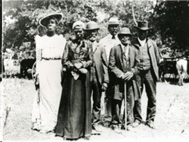 Well-dressed African American men and women at a Juneteenth celebration